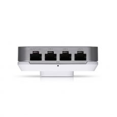 Bottom of the UAP In-Wall HD with four Ethernet ports