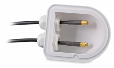 Example view of the underside with two coaxial cables passed through